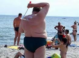 fat man on beach